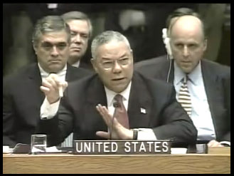 Colin Powell displays a vial of anthrax during his presentation to the UN security council, February 5, 2003